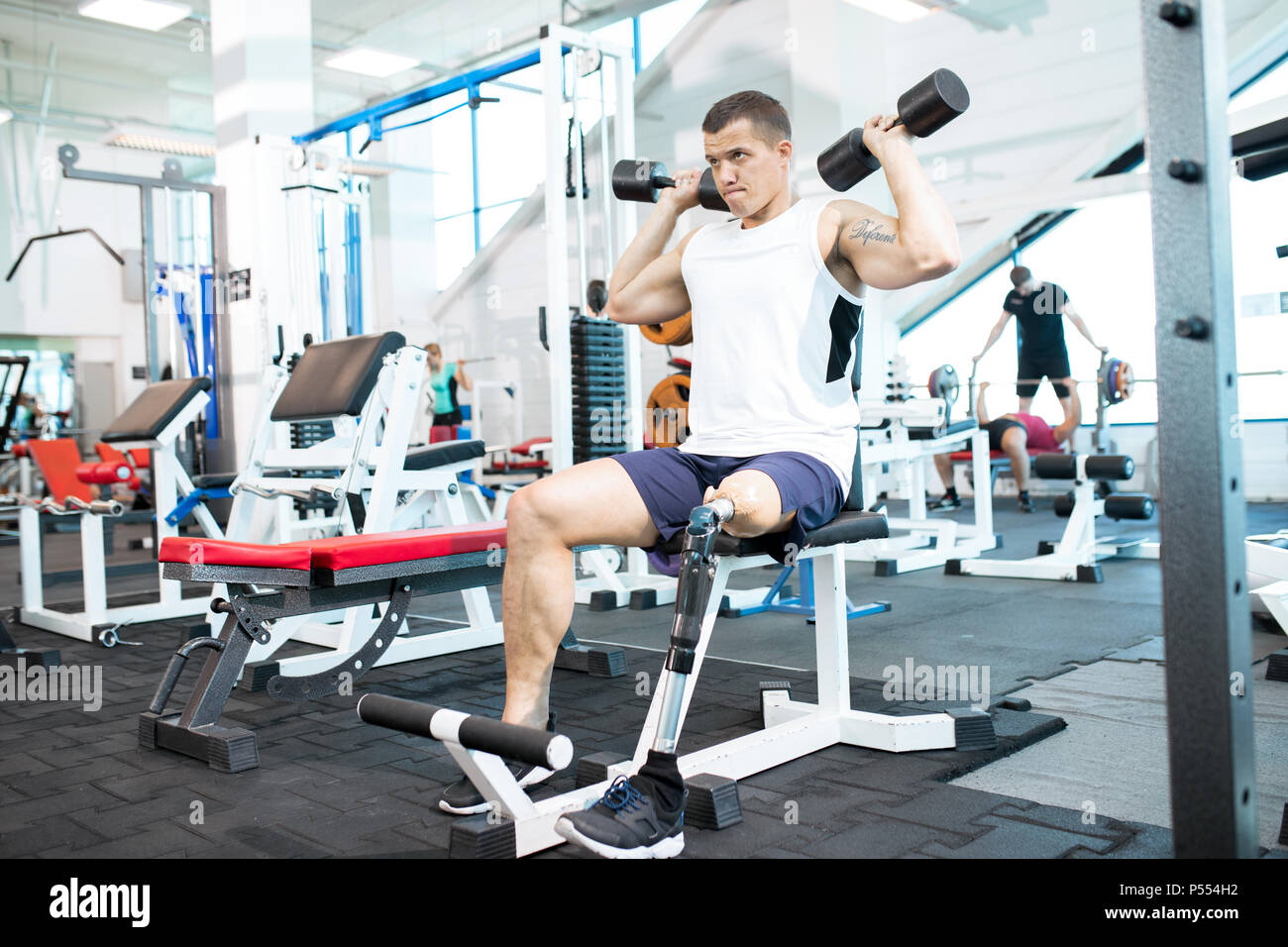 Handicapped Sportsman Training in Gym - Stock Image