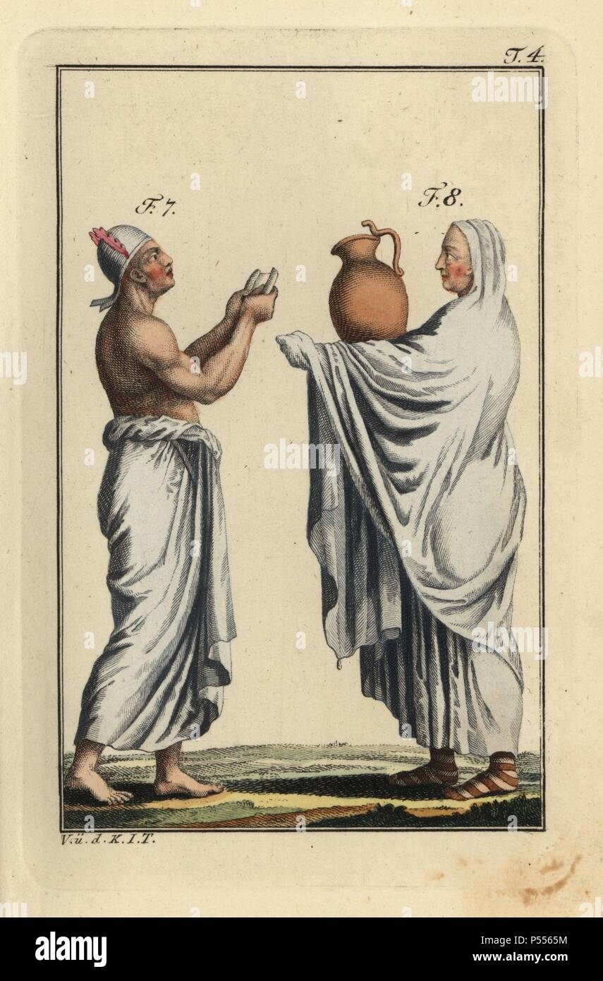 Egyptian priest with scroll and another priest with waterjug. Handcolored copperplate engraving from Robert von Spalart's 'Historical Picture of the Costumes of the Principal People of Antiquity and of the Middle Ages' (1796). - Stock Image