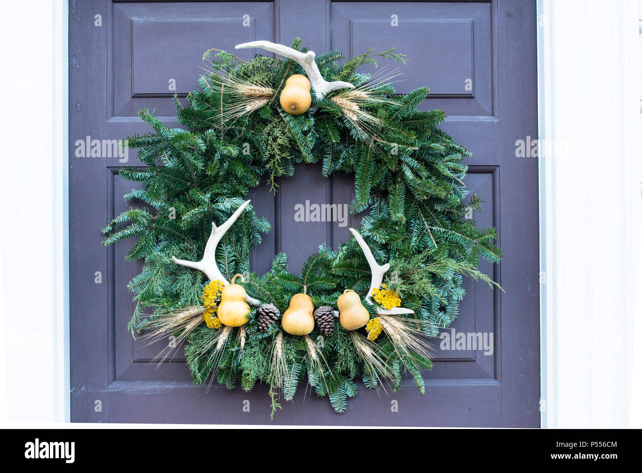 pear antlers and pine cone natural christmas wreath entered into the annual colonial williamsburg crafts