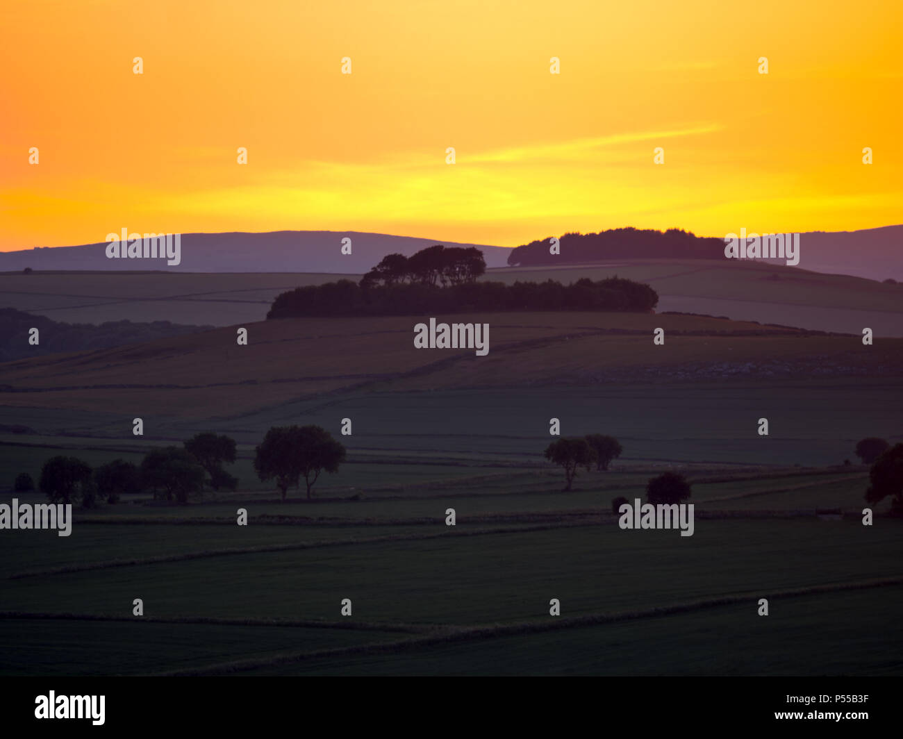 Harborough Rocks, Peak District, UK. 24th June, 2018. Weather UK: Sunset over Minning Low hill Historic England monument with a chambered tomb & two bowl barrows viewed from Harborough Rocks, Peak District National Park, Derbyshire, UK Credit: Doug Blane/Alamy Live News Stock Photo