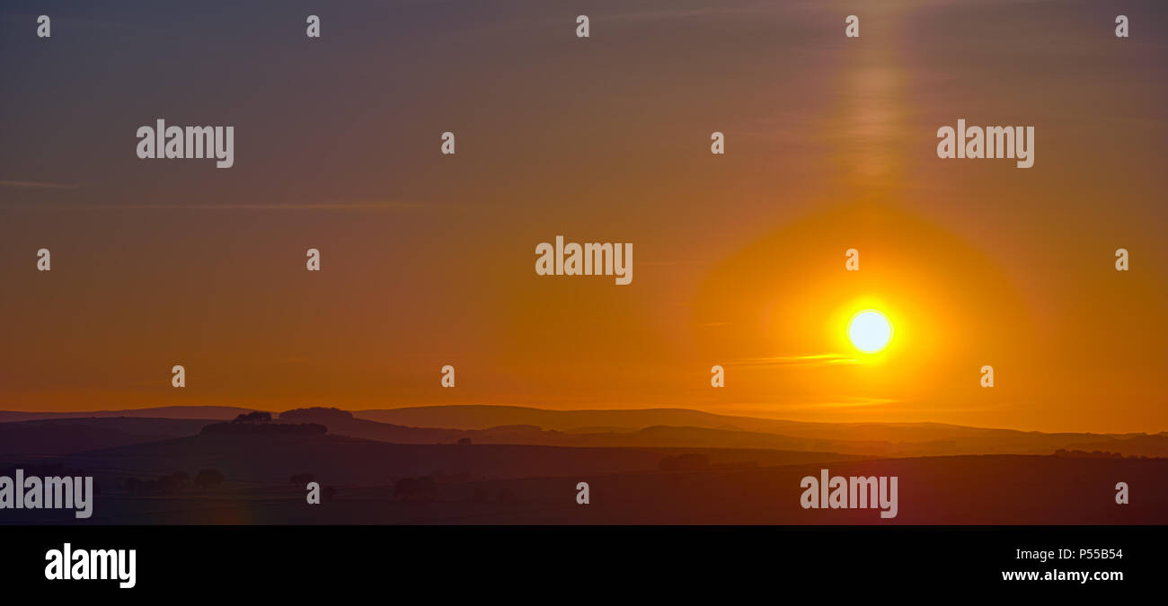 Harborough Rocks, Peak District, UK. 24th June, 2018. Weather UK: Sunset over Minning Low hill Historic England monument with a chambered tomb & two bowl barrows viewed from Harborough Rocks, Peak District, UK Credit: Doug Blane/Alamy Live News - Stock Image