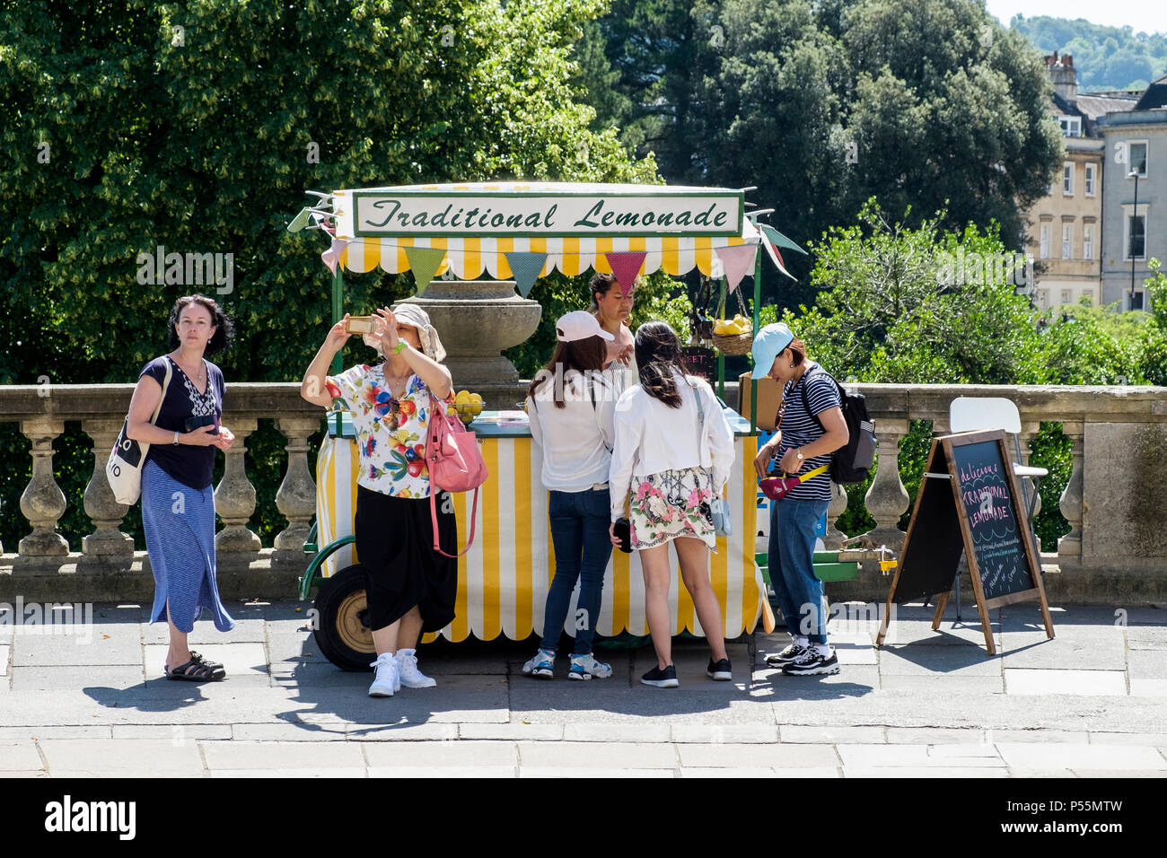 Bath, UK, 25th June, 2018.  As Bath enjoys another hot and sunny day tourists are pictured buying some cool refreshing traditional lemonade, forecasters predict that the warm weather will continue into next week. Credit: lynchpics/Alamy Live News - Stock Image