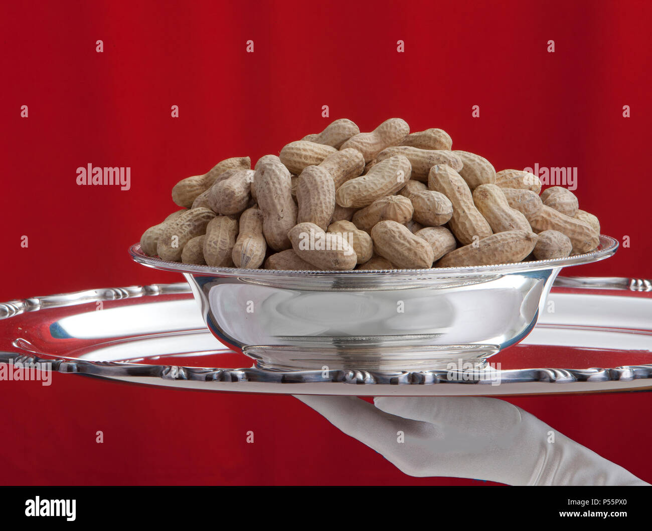 Peanuts served on a silver tray - Stock Image