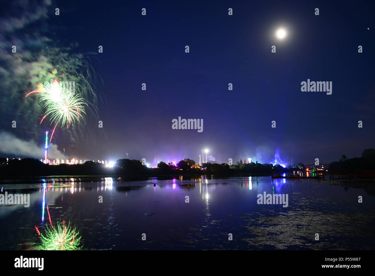 Newport, Isle of Wight, UK. Fireworks and a near full moon herald the end of the last day of the Isle of Wight Festival 2018. - Stock Image