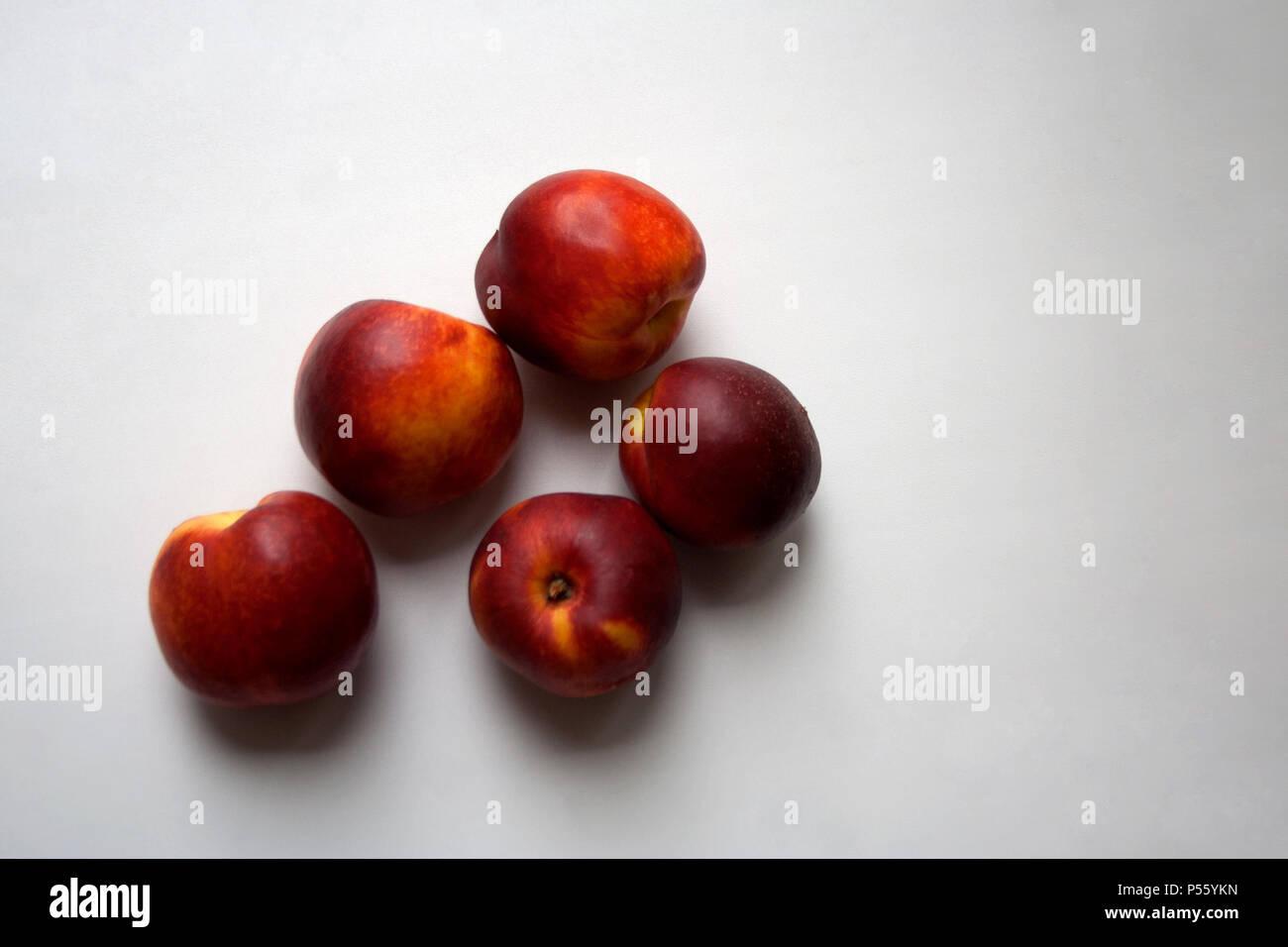 Nectarine fruits isolated on white background close up - Stock Image