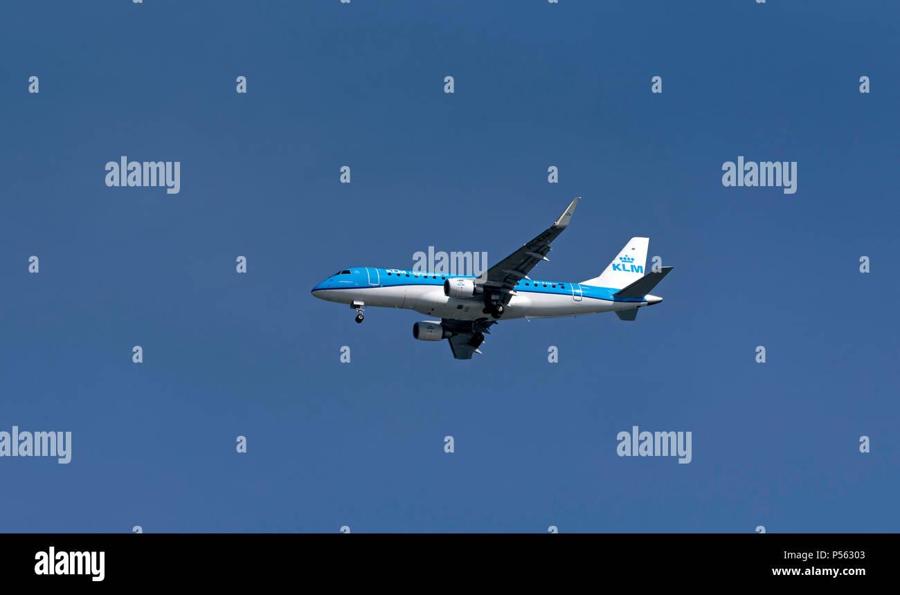 Southampton, England UK. 2018. A KLM Embraer ERJ passenger jet on finals into Southampton International Airport. - Stock Image