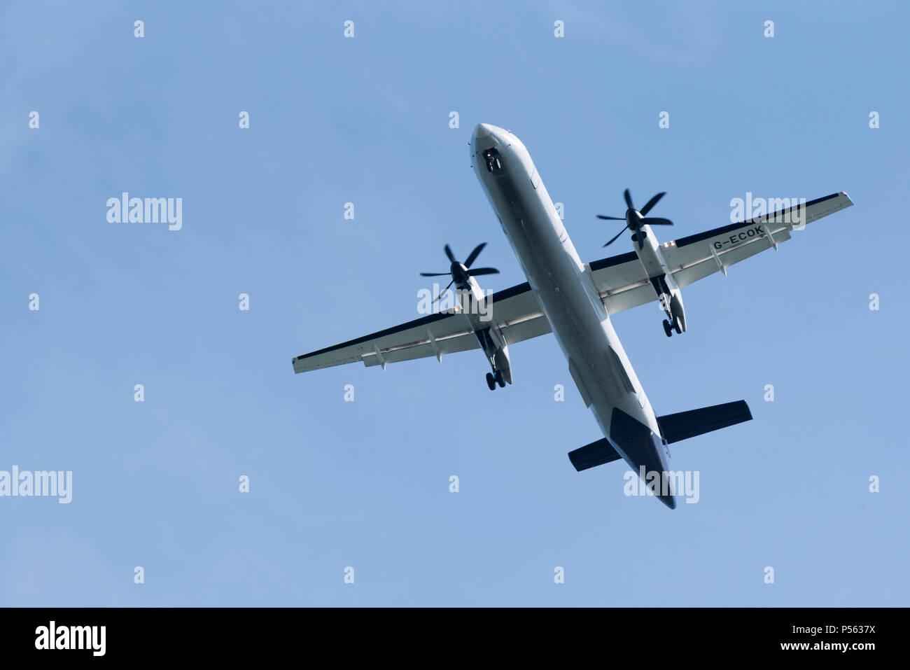 A Bombardier Dash 8 passenger aircraft on finals to land. Southampton UK - Stock Image