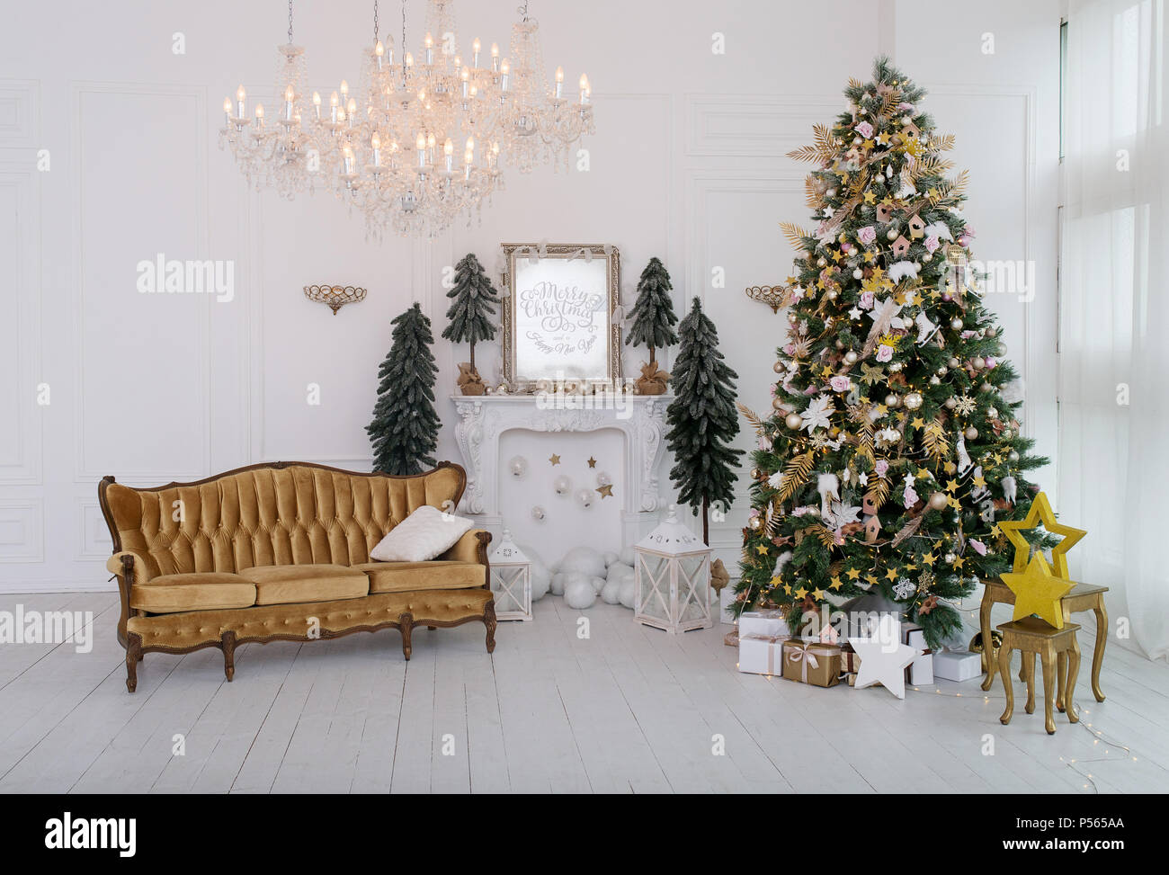 The bedroom decorated by Christmas. In the room there is a New Year's fir-tree decorated with toys and garlands. - Stock Image