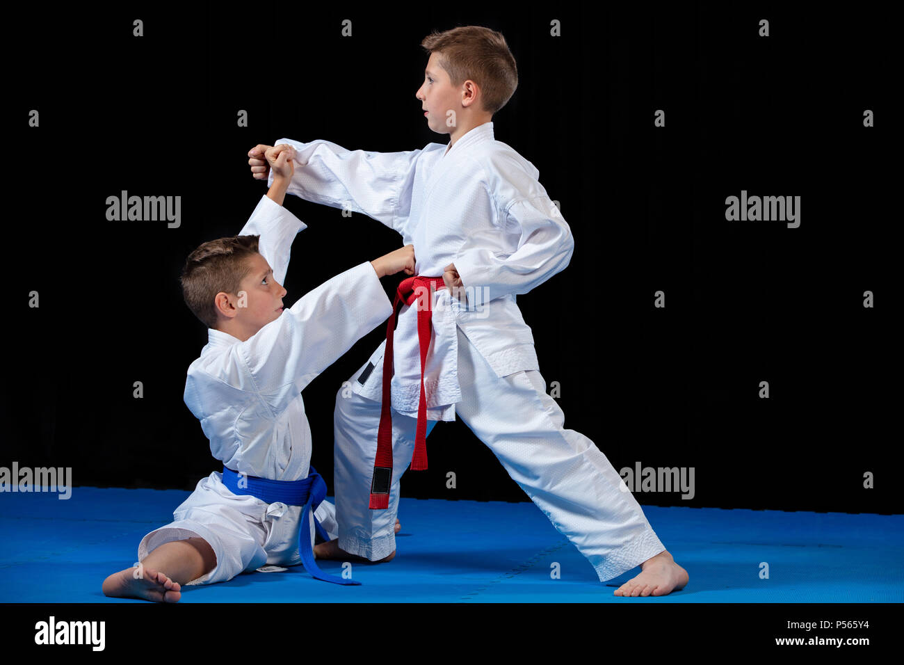 two boys training karate kata exercises at test qualification - Stock Image