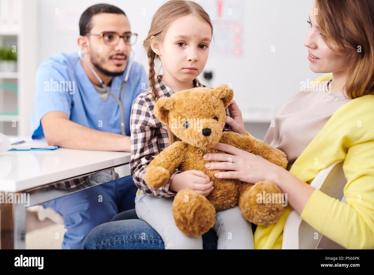 Pediatrician Examining Little Girl - Stock Image