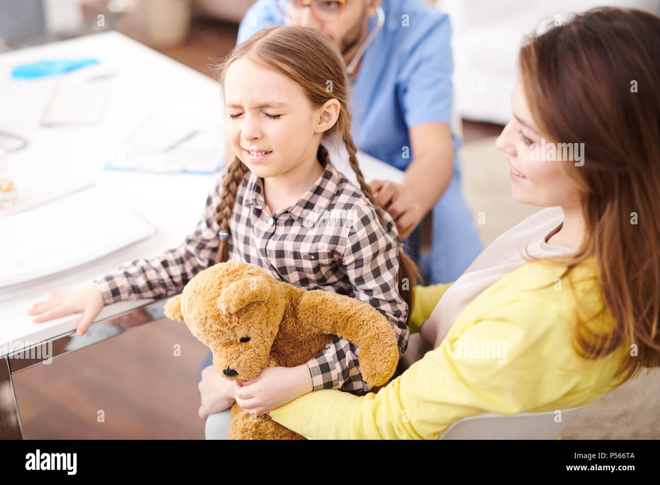 Scared Little Girl in Health Check up - Stock Image