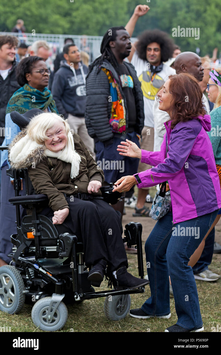 Candid image of a woman with a disability enjoying the music at the 2018 Africa Oye music festival in Sefton Park, Liverpool. - Stock Image