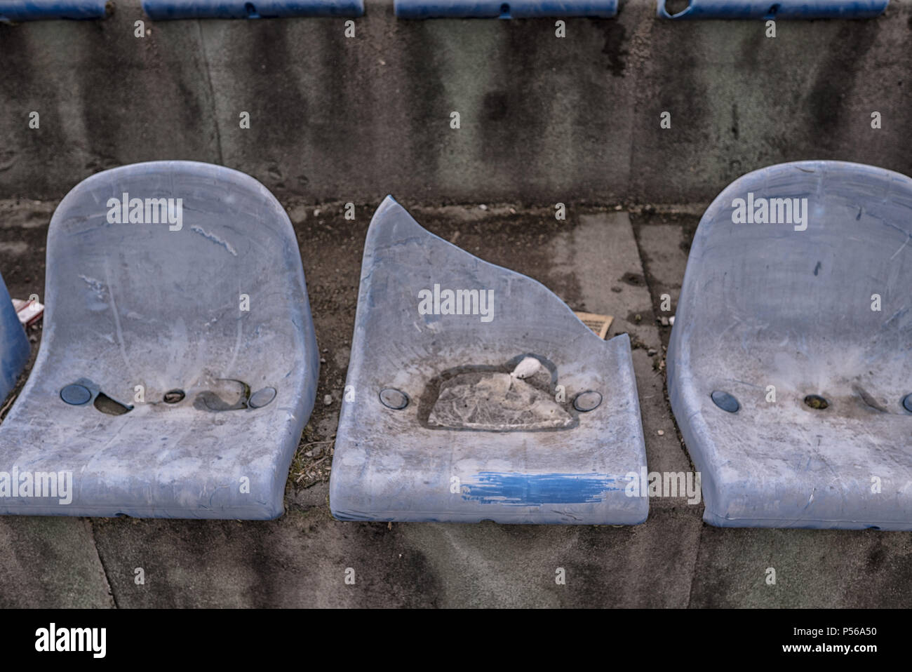 Vintage Stadium Chairs old time not used with dust blue color - Stock Image