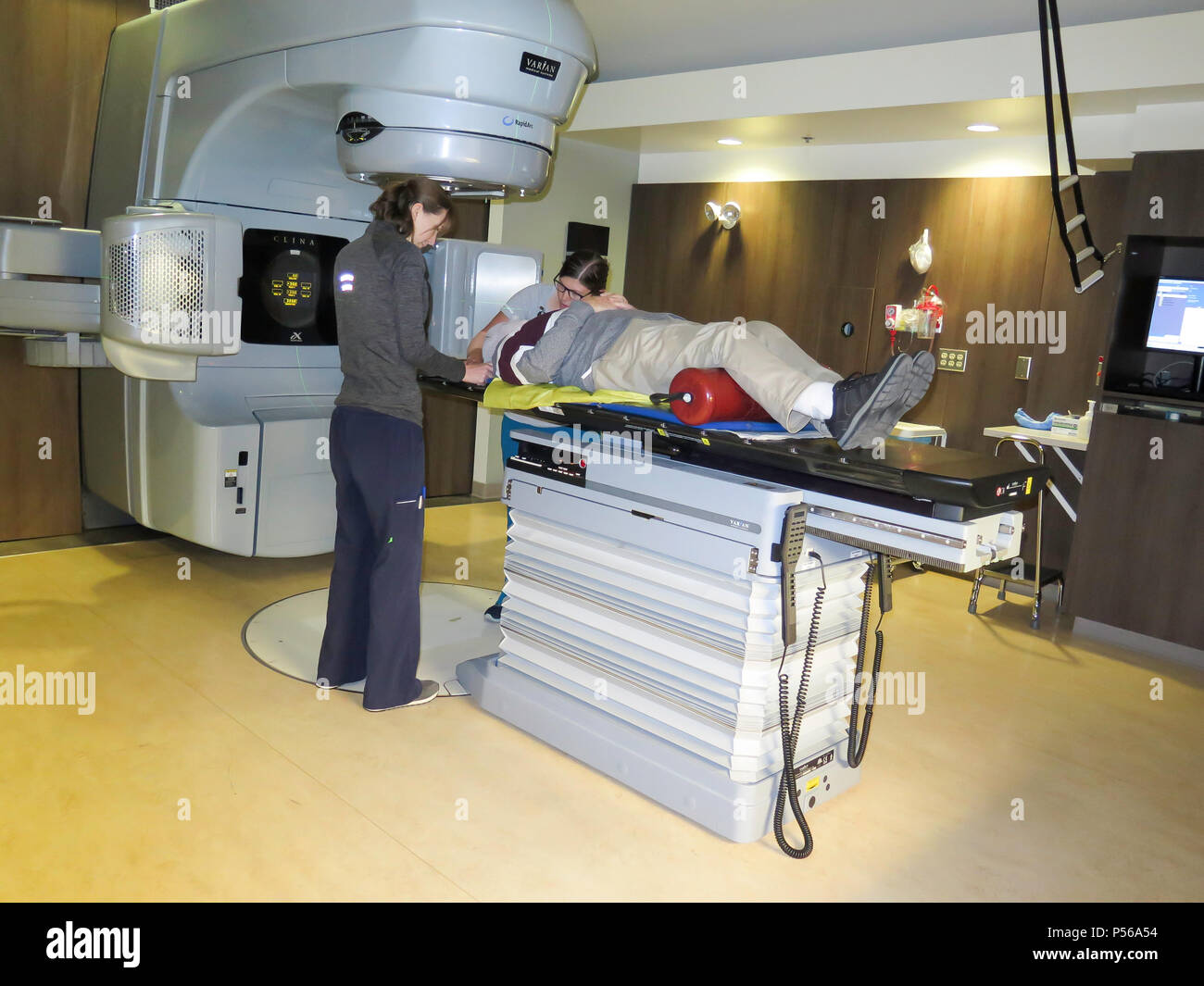 Adult Man receives Radiation Therapy his head  in a Hospital environment - Stock Image