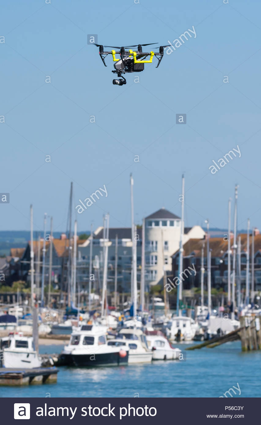DJI Inspire 2 Quadcopter fitted with a video camera flying over the River Arun in Littlehampton, West Sussex, England, UK. - Stock Image