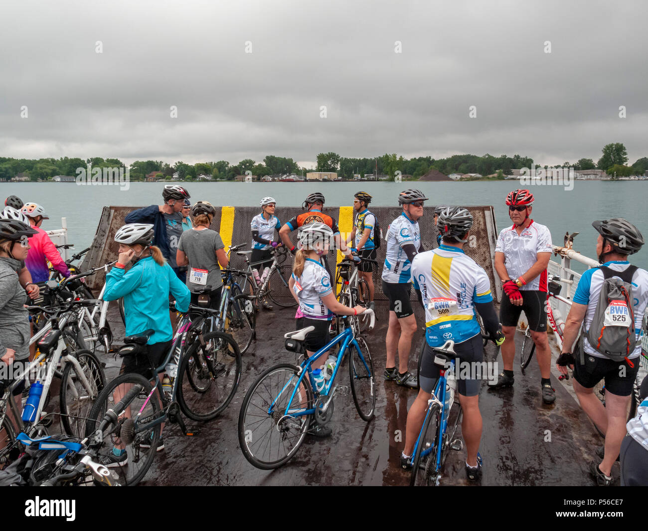 Harsens Island, Michigan - On a rainy Sunday, bicycle riders take the ferry to Harsens Island to participate in the annual Blue Water Ramble. Riders c - Stock Image