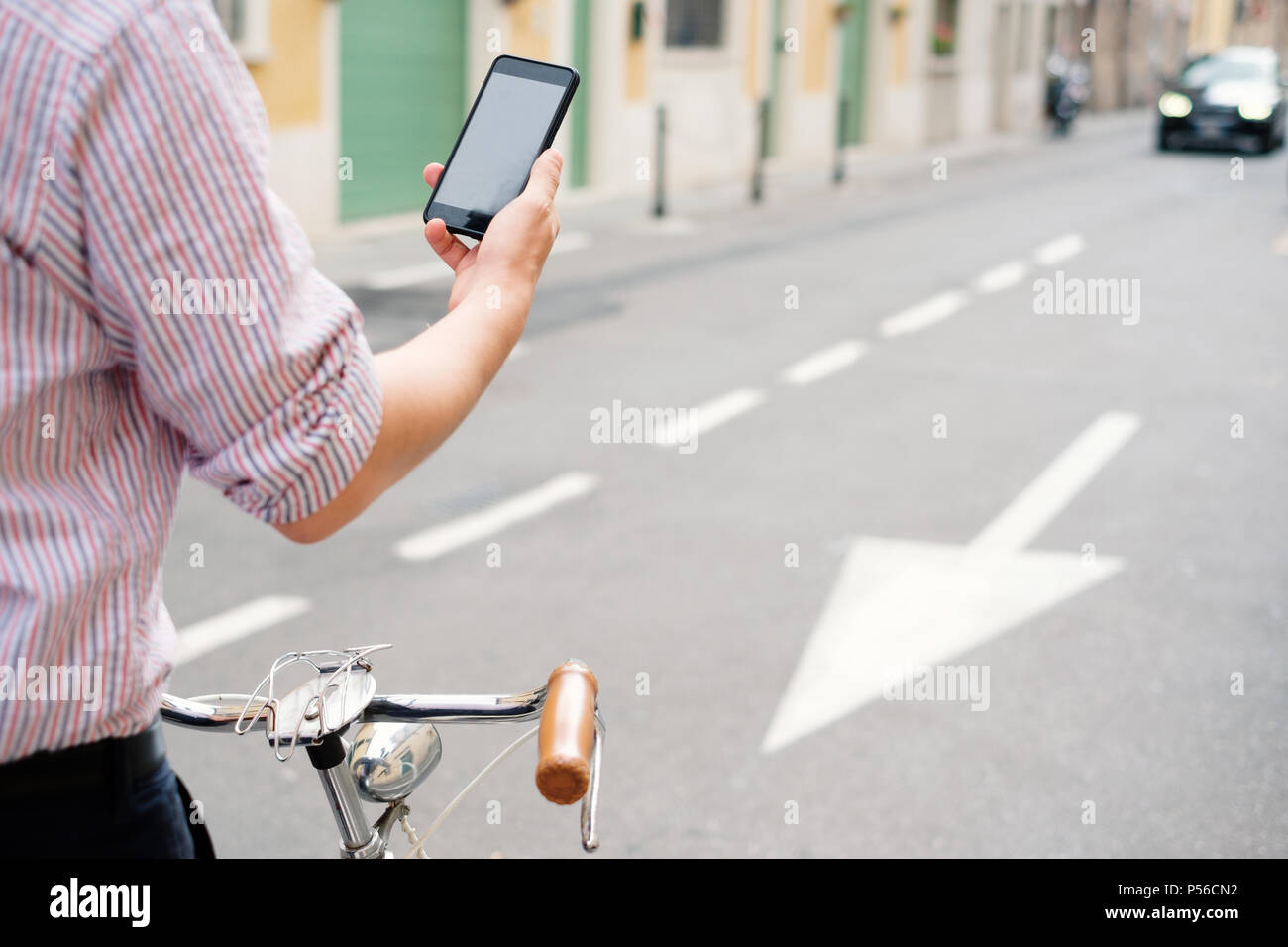 Dangerous mobile phone distraction in the city traffic , road safety concept - Stock Image