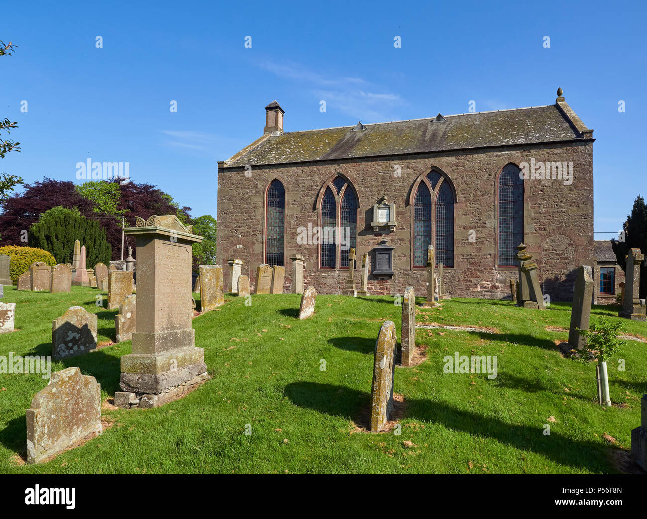 A side view of Monikie Kirk, and Old Red Sandstone constructed Church near to Dundee in Angus, Scotland. - Stock Image