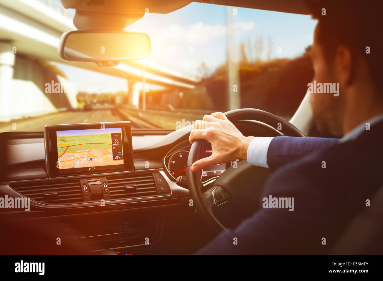 Man diving car with navigation system Stock Photo