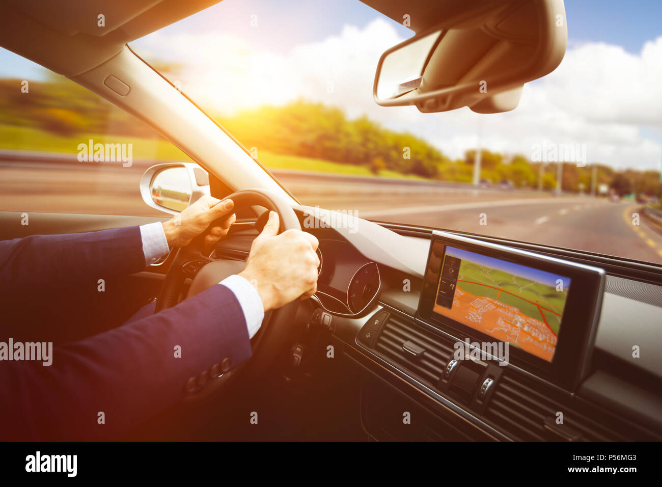 Side view of steering wheel and navigation system - Stock Image