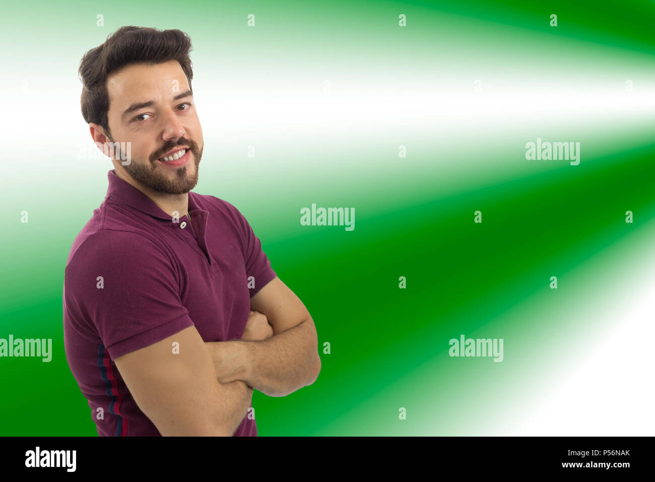 Friendly and confident man. Concept of confidence and security. Beautiful and bearded person. He is wearing a magenta polo shirt. White background, is - Stock Image