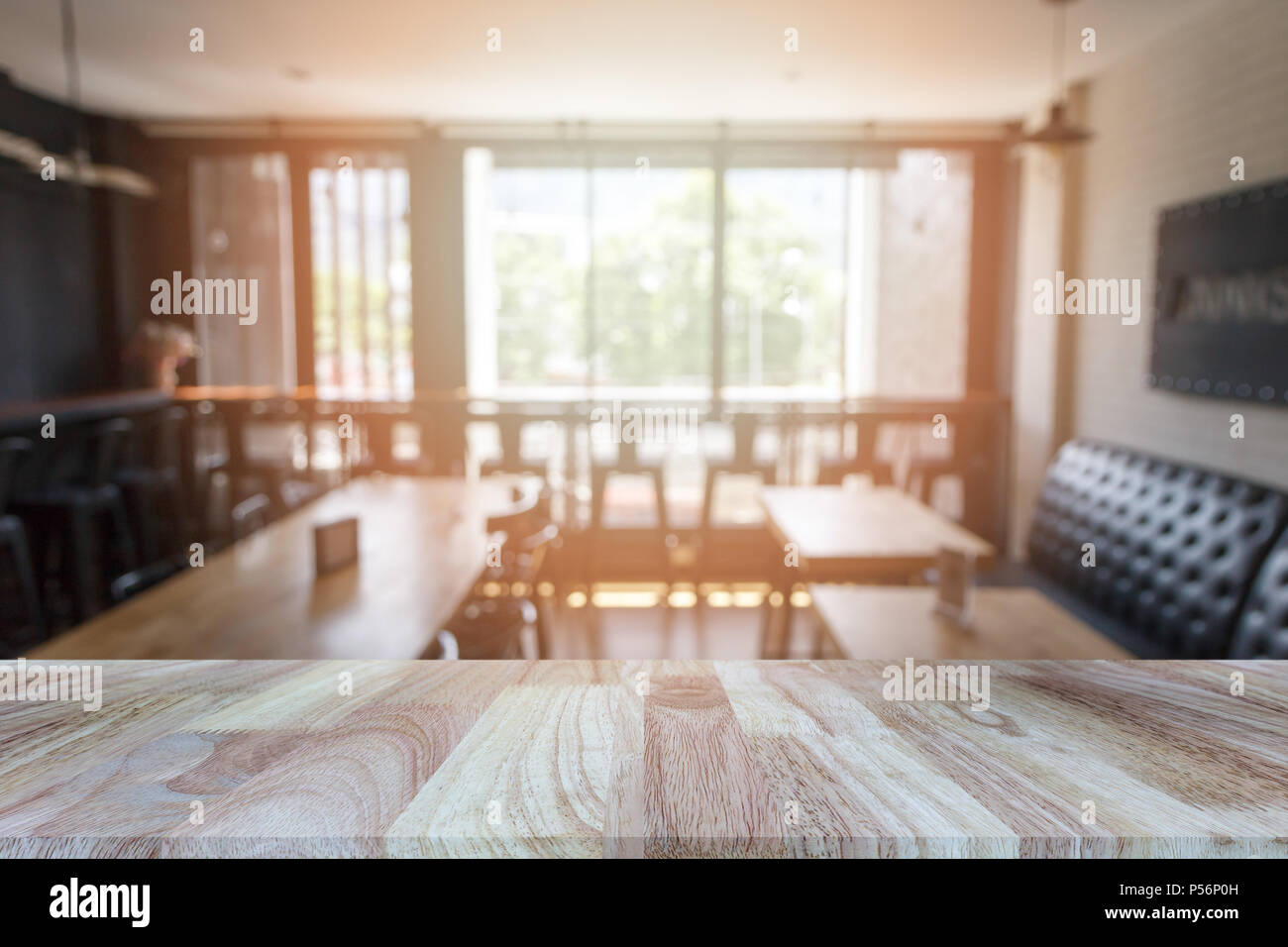 Wooden Tabletop On Blurred Restaurant Or Coffee Shop Background Can Be Used For Display Or Montage Your Products Stock Photo Alamy