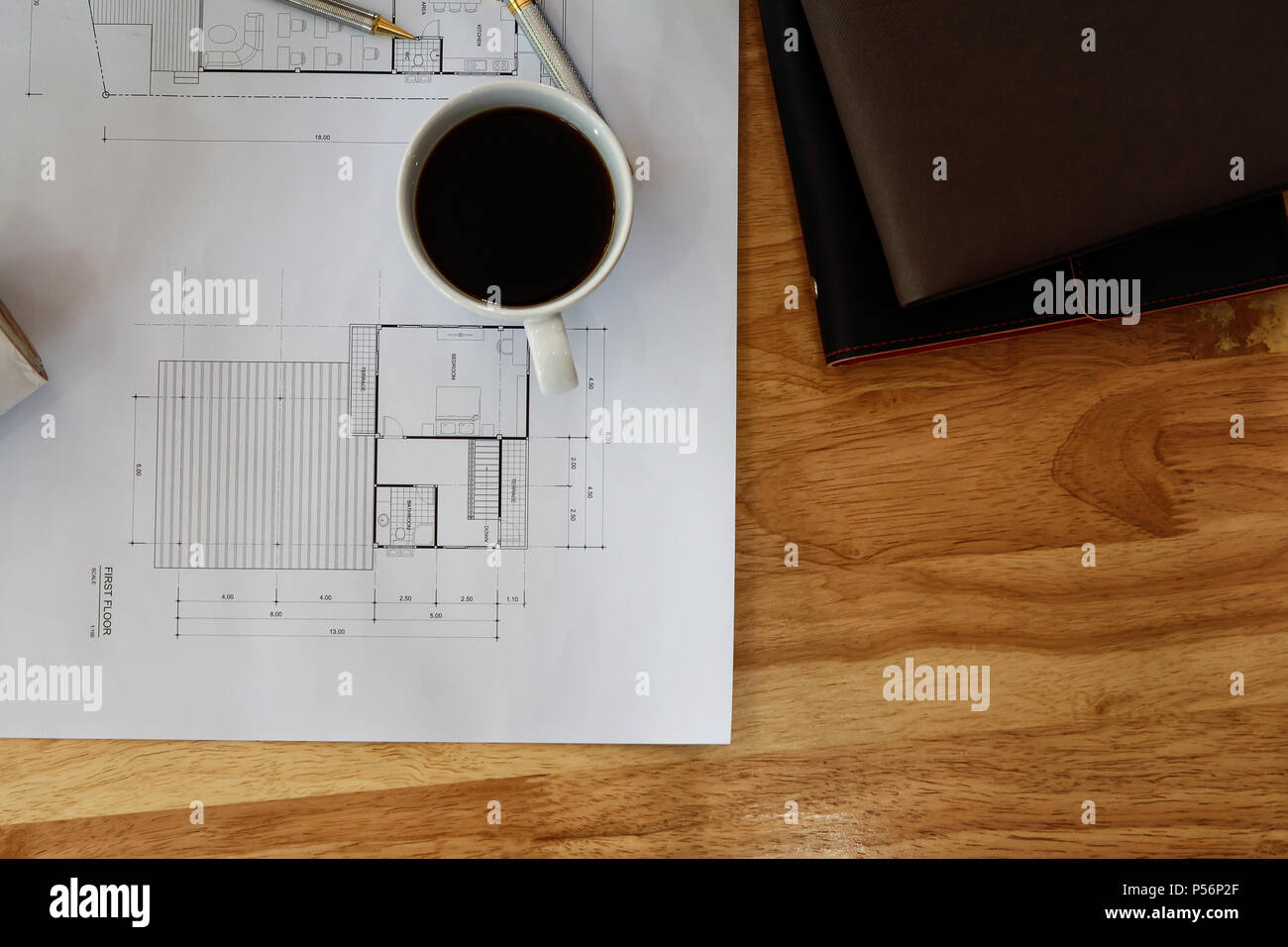 Top view of cup of coffee with measurement tool and blueprint, architectural concept - Stock Image