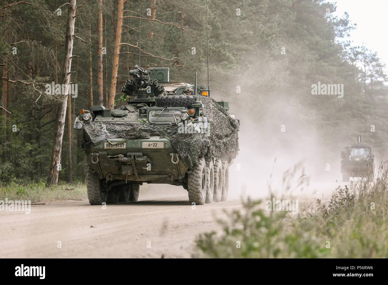A Stryker Infantry Carrier Vehicle departs Rukla, Lithuania to begin preparations for the upcoming wet gap crossing, June 12, 2018, June 12, 2018. The Regimental Engineer Squadron, 2d Cavalry Regiment will facilitate a wet gap crossing with the 130th Deutsch Engineer Battalion. () - Stock Image