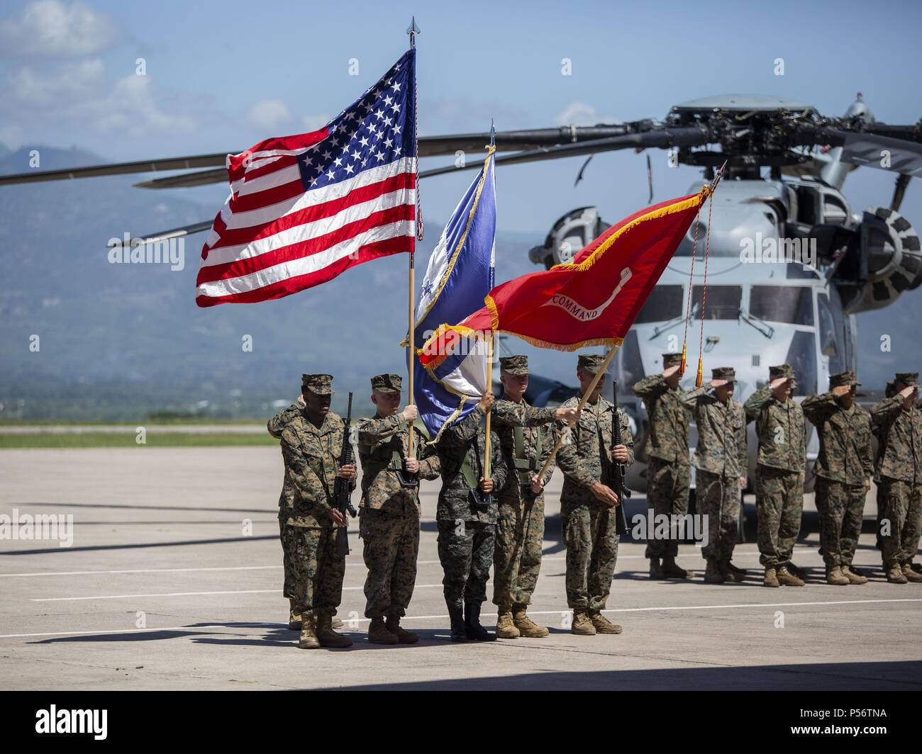 A multinational color guard comprised of Marines with Special Purpose Marine Air-Ground Task Force - Southern Command and a Honduran Army soldier present colors during an opening ceremony on Soto Cano Air Base, Honduras, to mark the beginning of SPMAGTF-SC deployment to Latin America and the Caribbean, June 11, 2018, June 11, 2018. The Marines and sailors of SPMAGTF-SC will conduct security cooperation training and engineering projects alongside partner nation military forces in Central and South America during their deployment. The unit is also on standby to provide humanitarian assistance an Stock Photo