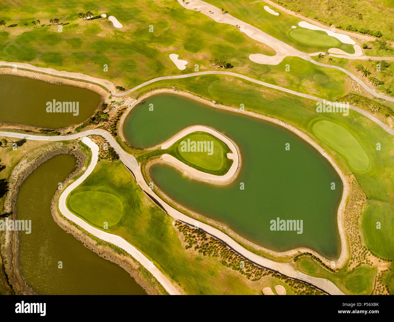 Par Three Island Green Surrounded By Water - Stock Image