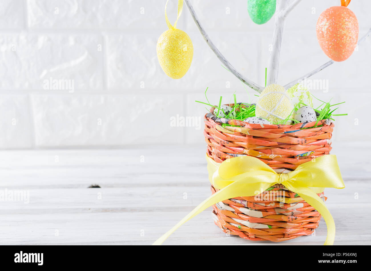 Closeup Of Colorful Easter Eggs And Toys On Tree Branches In