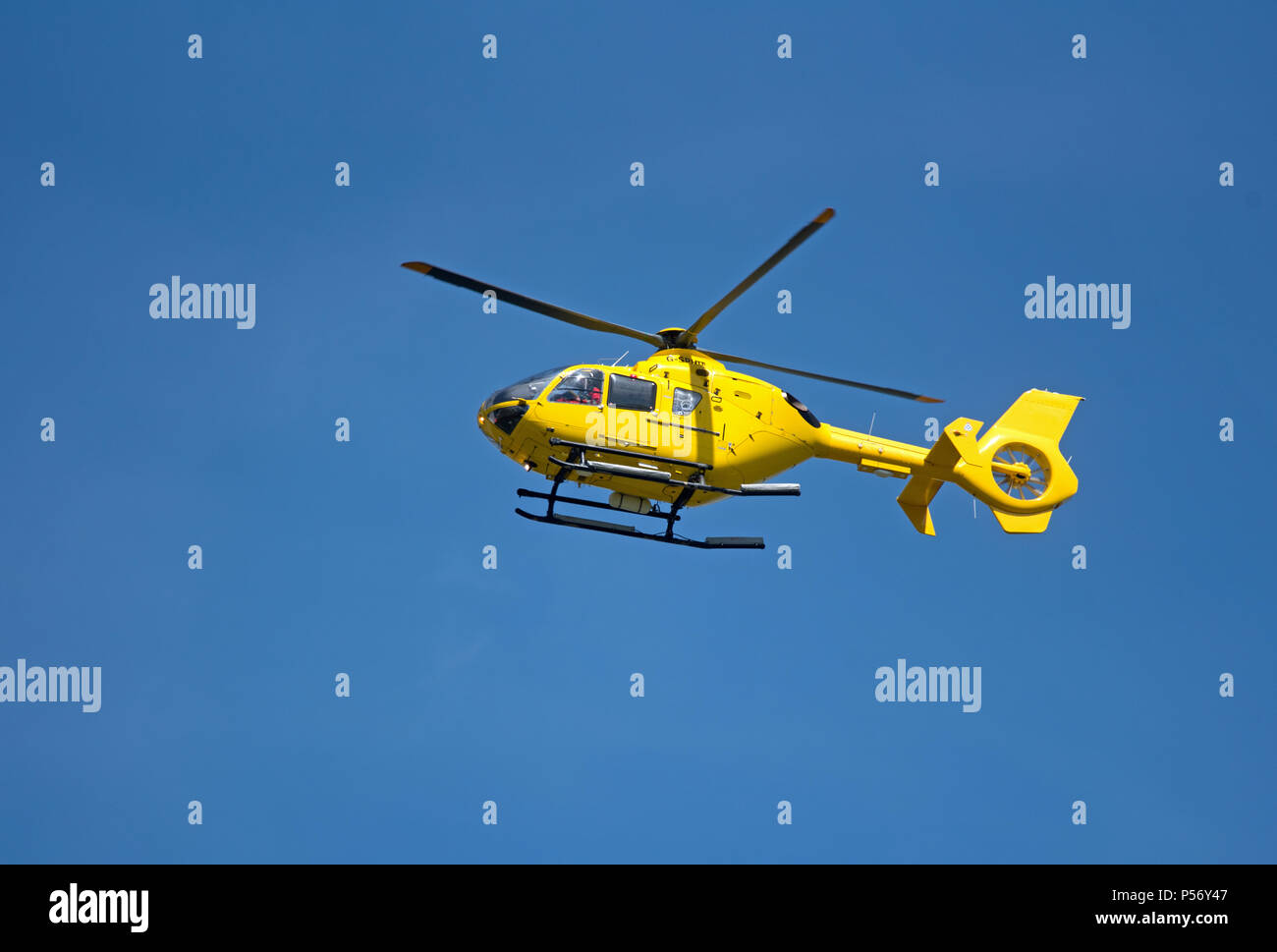 Inverness Based Helimed EC135 T2 returning to based at Inverness Dalcross Airport, in the Scottish Highlands. - Stock Image