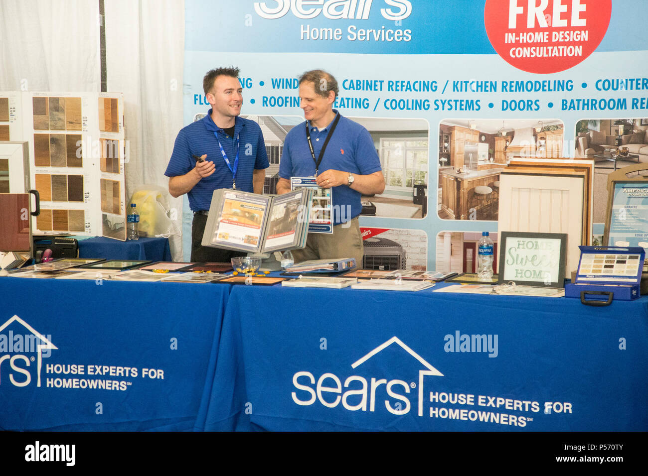 Home improvement salesmen at a trade show at MetLife Stadium in East Rutherford, NJ - Stock Image