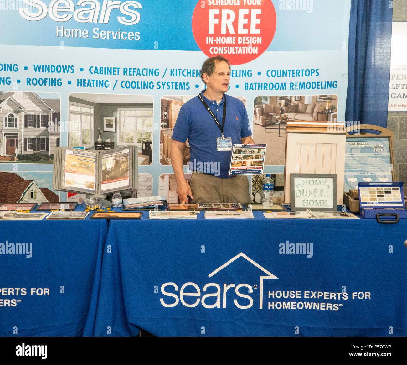 Home improvement salesman at a trade show at MetLife Stadium in East Rutherford, NJ - Stock Image