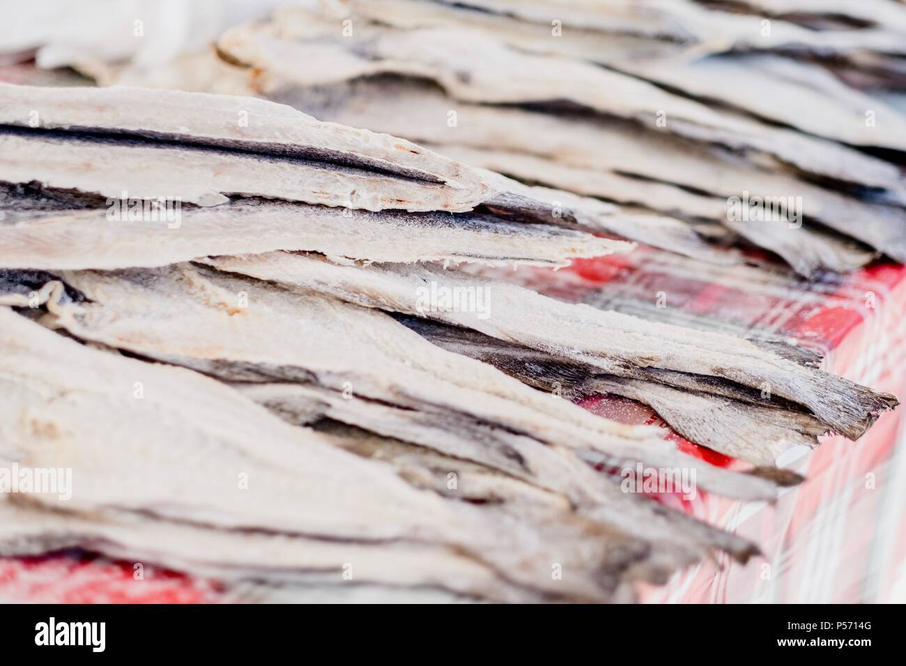 Dried, salted codfish is a traditional portuguese fish sold on the open air market - Stock Image