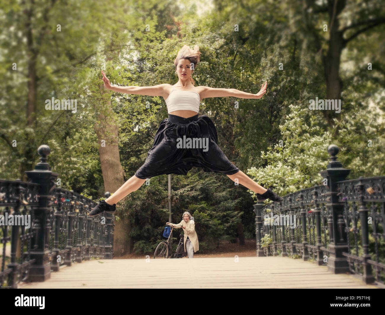 Young woman dancing at Vondelpark,Amsterdam,Holland - Stock Image