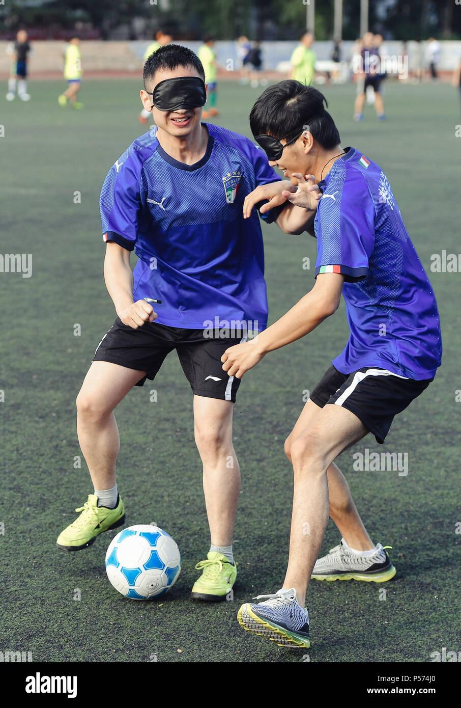 (180625) -- BEIJING, June 25, 2018 (Xinhua) -- Sun Dongyuan (R) and Fan  Changjie play football at the special education school of Changchun  University in ...