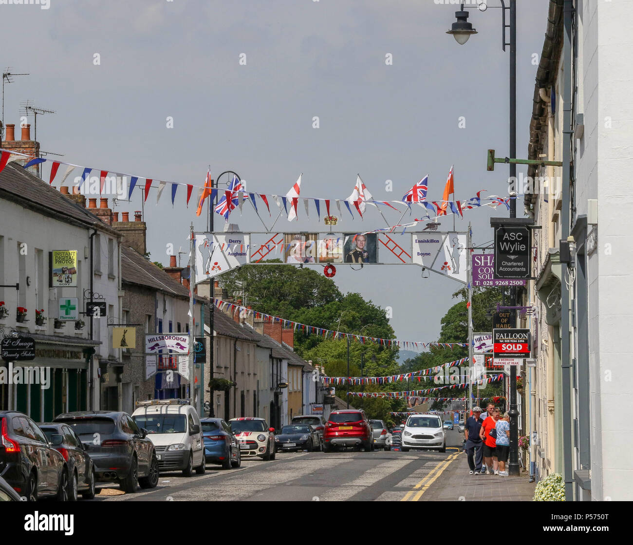 Hillsborough, County Down, Northern Ireland. 25 June 2018. UK weather - another hot and sunny day as high pressure sits over Northern Ireland and the UK. Hot sunny bright and colourful in Hillsborough County Down with the Oranage Arch and bunting now up ahead of the traditional marching season in Northern Ireland.Credit: David Hunter/Alamy Live News. - Stock Image