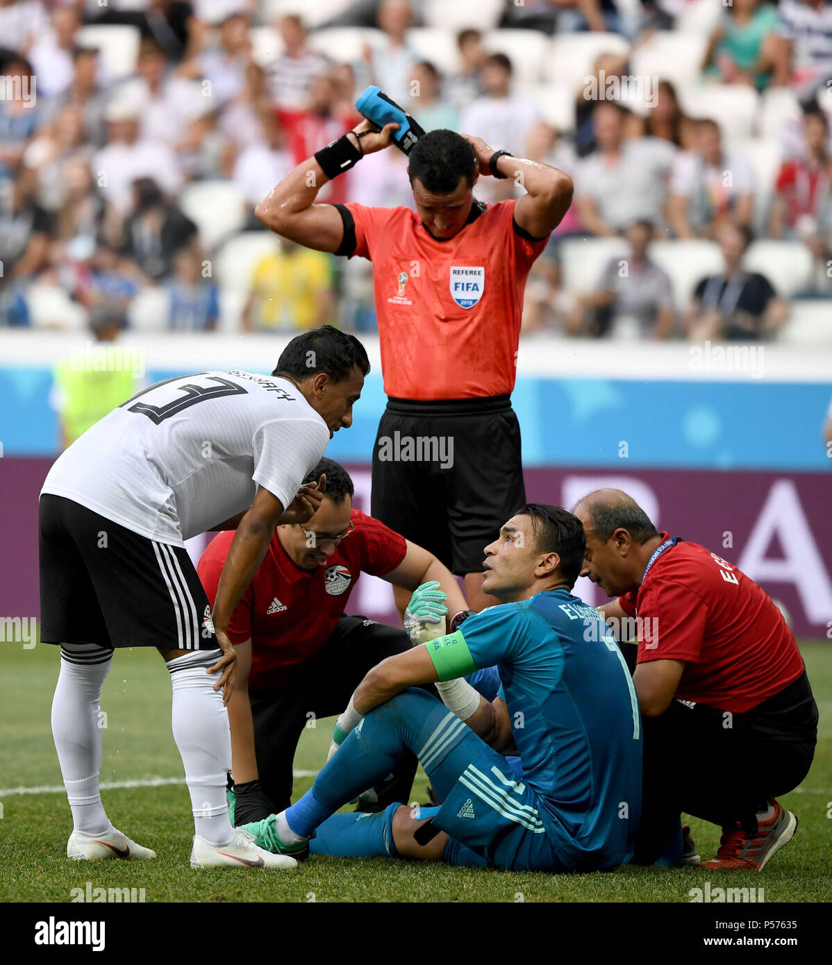 Egypt s goalkeeper Essam El Hadary (2nd R) receives medical treatment after  his injury during the 2018 FIFA World Cup Group A match between Saudi  Arabia and ... 3c924c9f9b52f