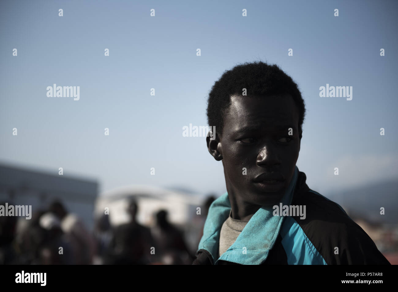 Motril, Granada, Spain. 25th June, 2018. Sub Saharan migrant look back as leave the rescue boat at Motril port. 96 migrants were rescued by Spanish Maritime Rescue and brought at Motril port. Today more than 500 migrants were rescued and assisted while they try to cross to Spain by dinghy. Credit: Carlos Gil/SOPA Images/ZUMA Wire/Alamy Live News - Stock Image