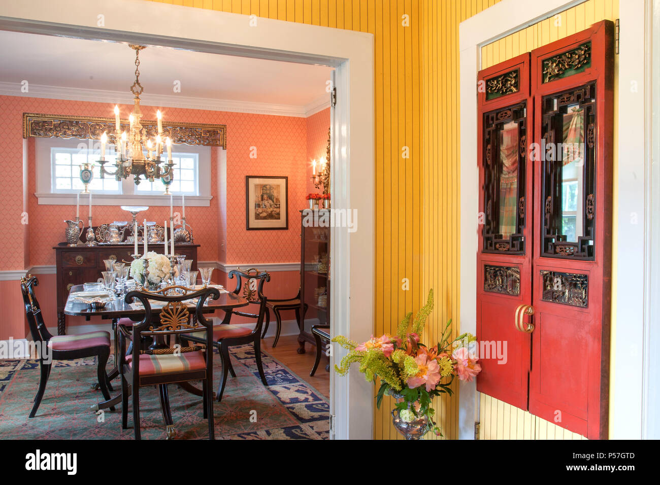 Dining Room And Front Entry Hall In A Brightly Colored Residential Home United States