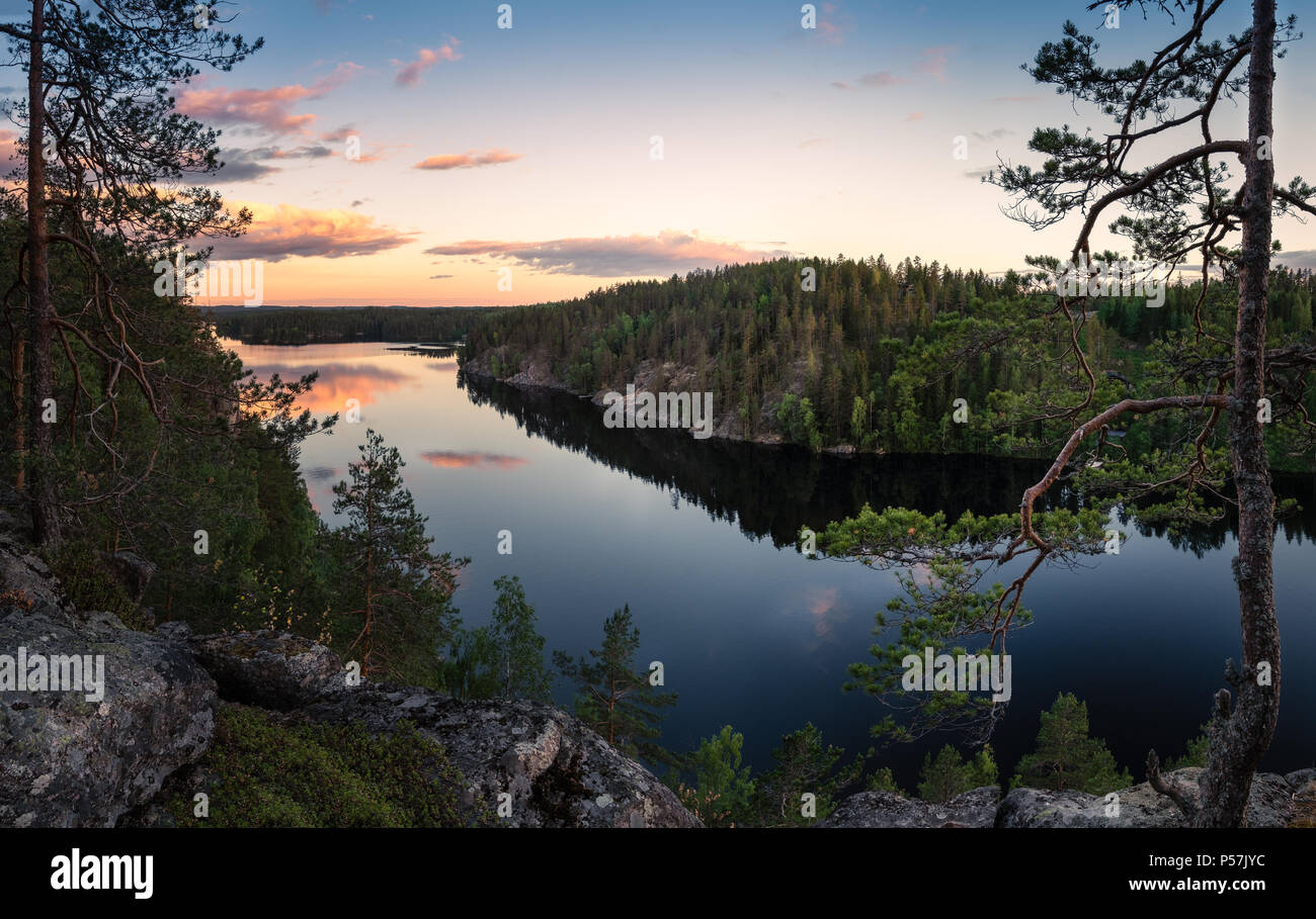 Scenic traditional Finnish landscape with lake and sunset at summer evening in Haukkavuori, Finland - Stock Image