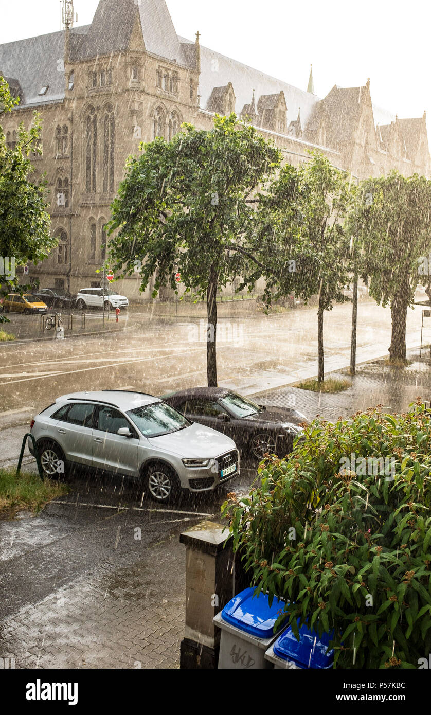 Strasbourg, cars parked on the pavement, summer shower of rain, Alsace, France, Europe, - Stock Image