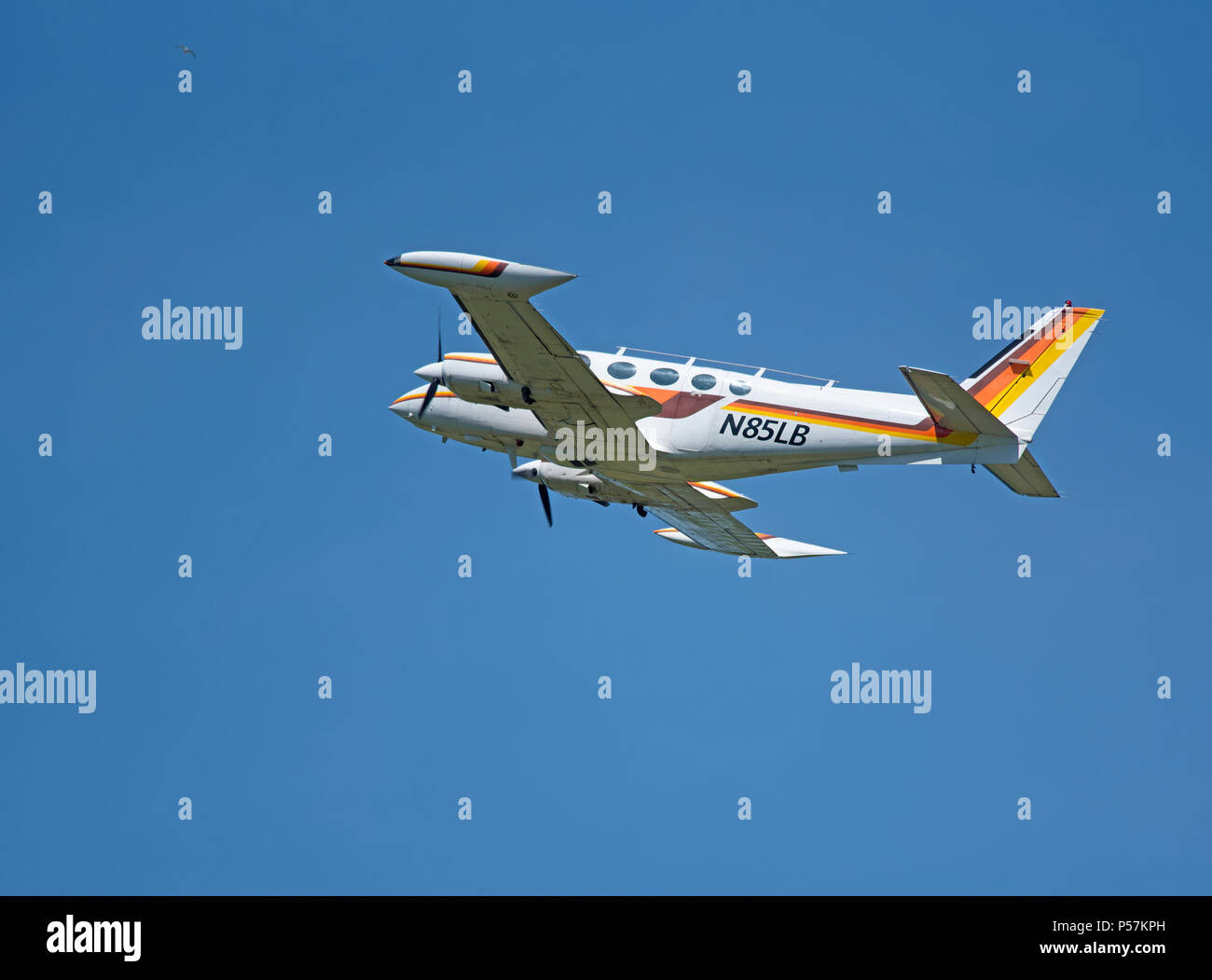 A piston powered propellor driven Cessna 340A Lifts off from Inverness Dalcross Airport in the Scottish Highlands. - Stock Image