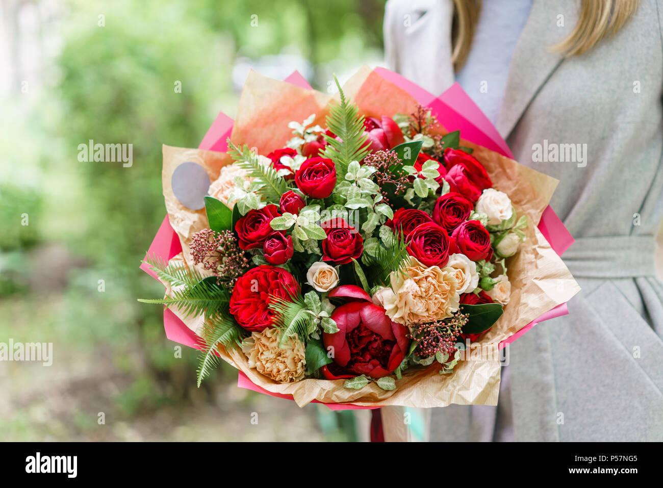 Young Girl Holding A Beautiful Spring Bouquet Flower Arrangement