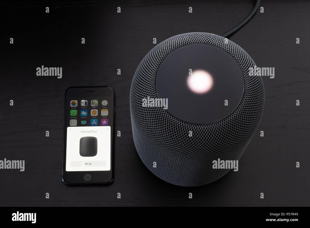 Installing an Apple HomePod speaker - Stock Image