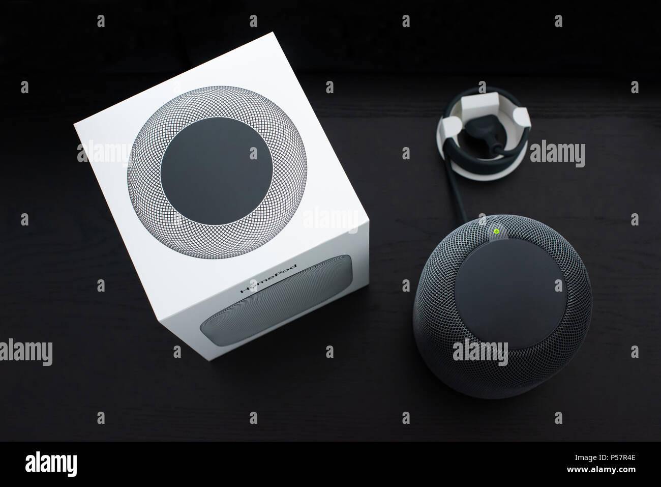Unboxing an Apple HomePod speaker - Stock Image