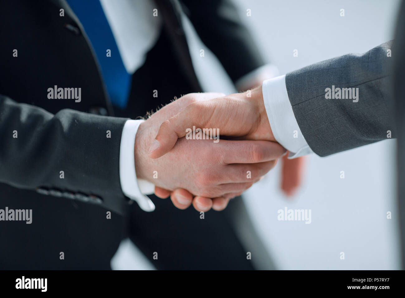 close up.reliable handshake of business partners - Stock Image