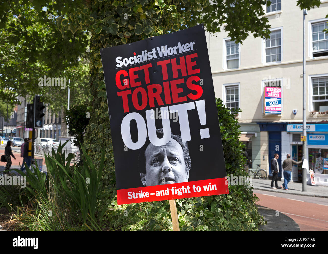 """A Socialist Workers Party placard with the slogan """"GET THE TORIES OUT"""" and a photograph of prime minister David Cameron in Bristol, UK on 30 May 2015 - Stock Image"""