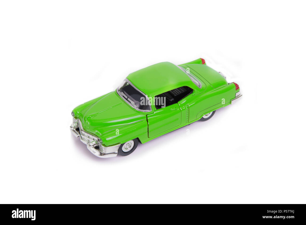 Green model toy car in retro style on white background. - Stock Image